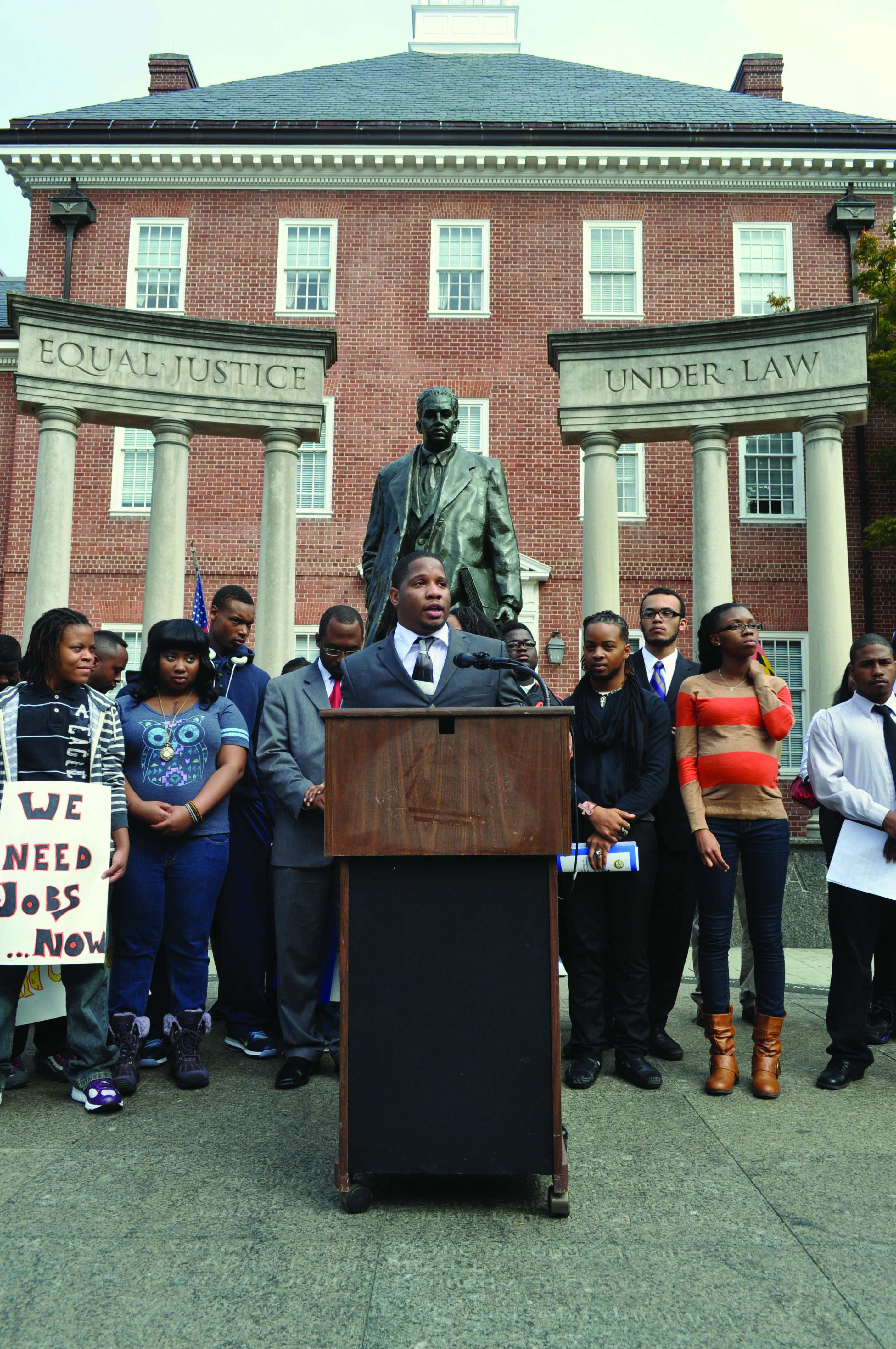 Dayvon Love speaks to a crowd protesting a new youth jail in Baltimore