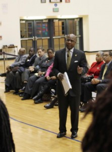 President David Wilson is flanked by administrators for Town Hall meeting