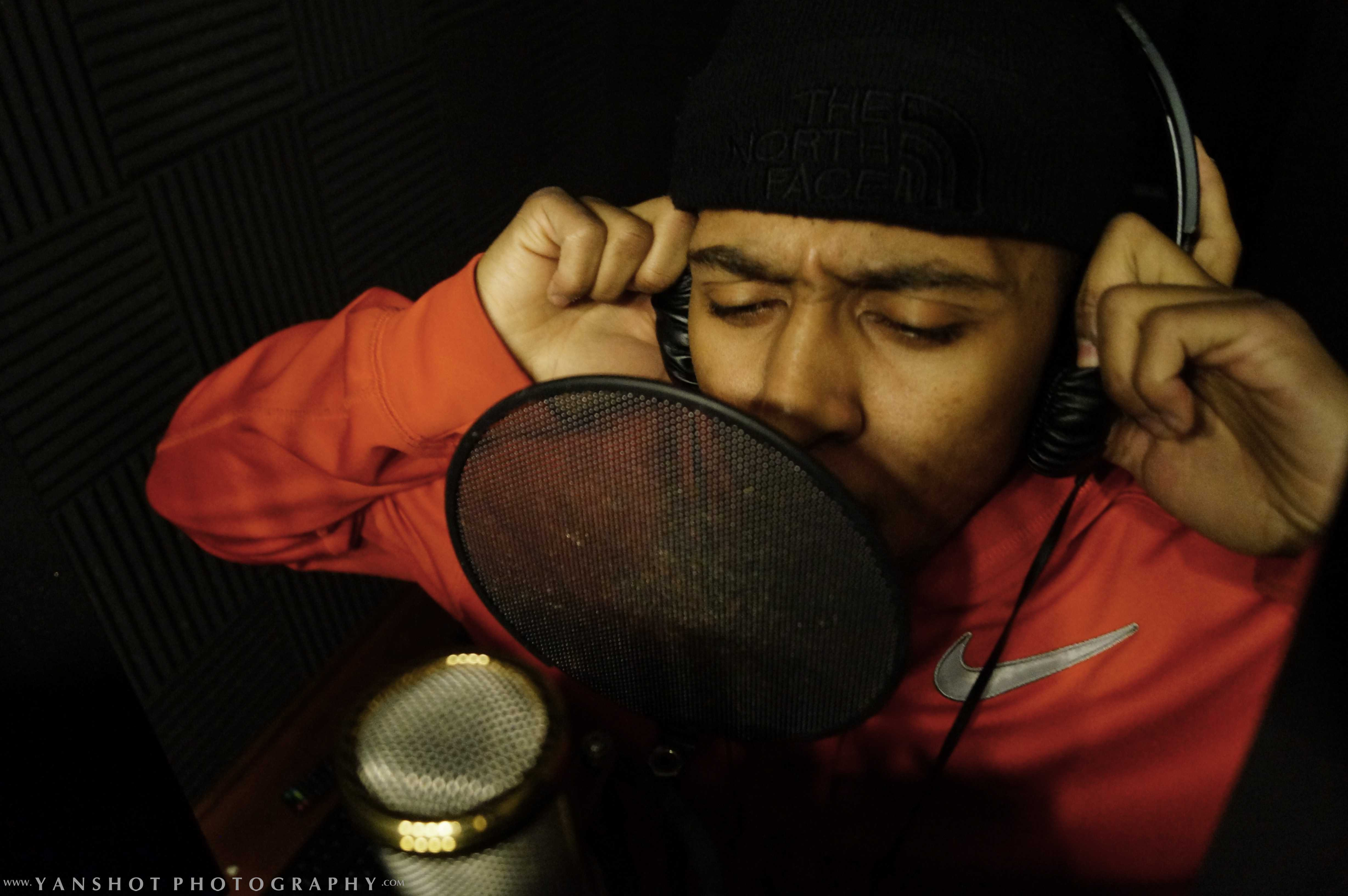 """Brandon """"B-Ezzy"""" Perry in the studio recording his song."""