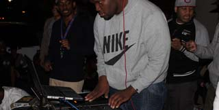 DJ Rell mixes Go-Go and Reggae on the University Student Center patio stage