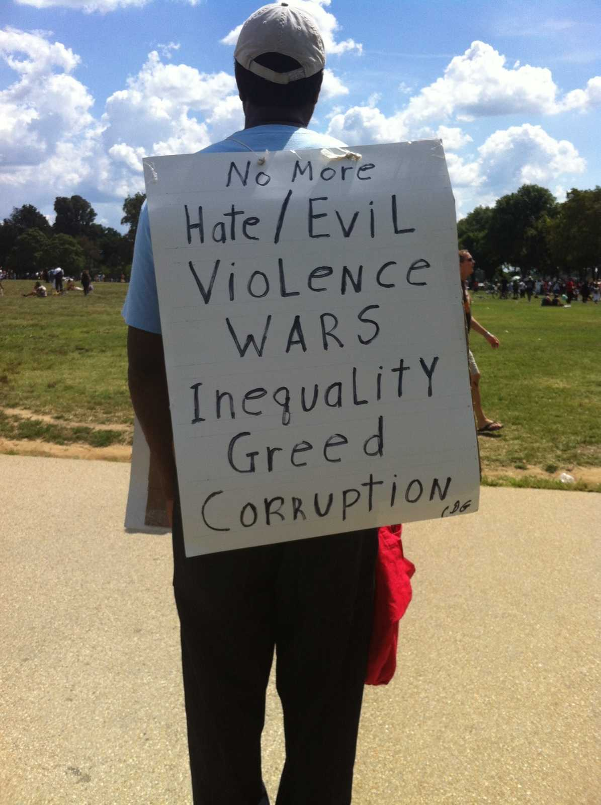 D.C. native Calvin Gilliam, 63, with his homemade sign.