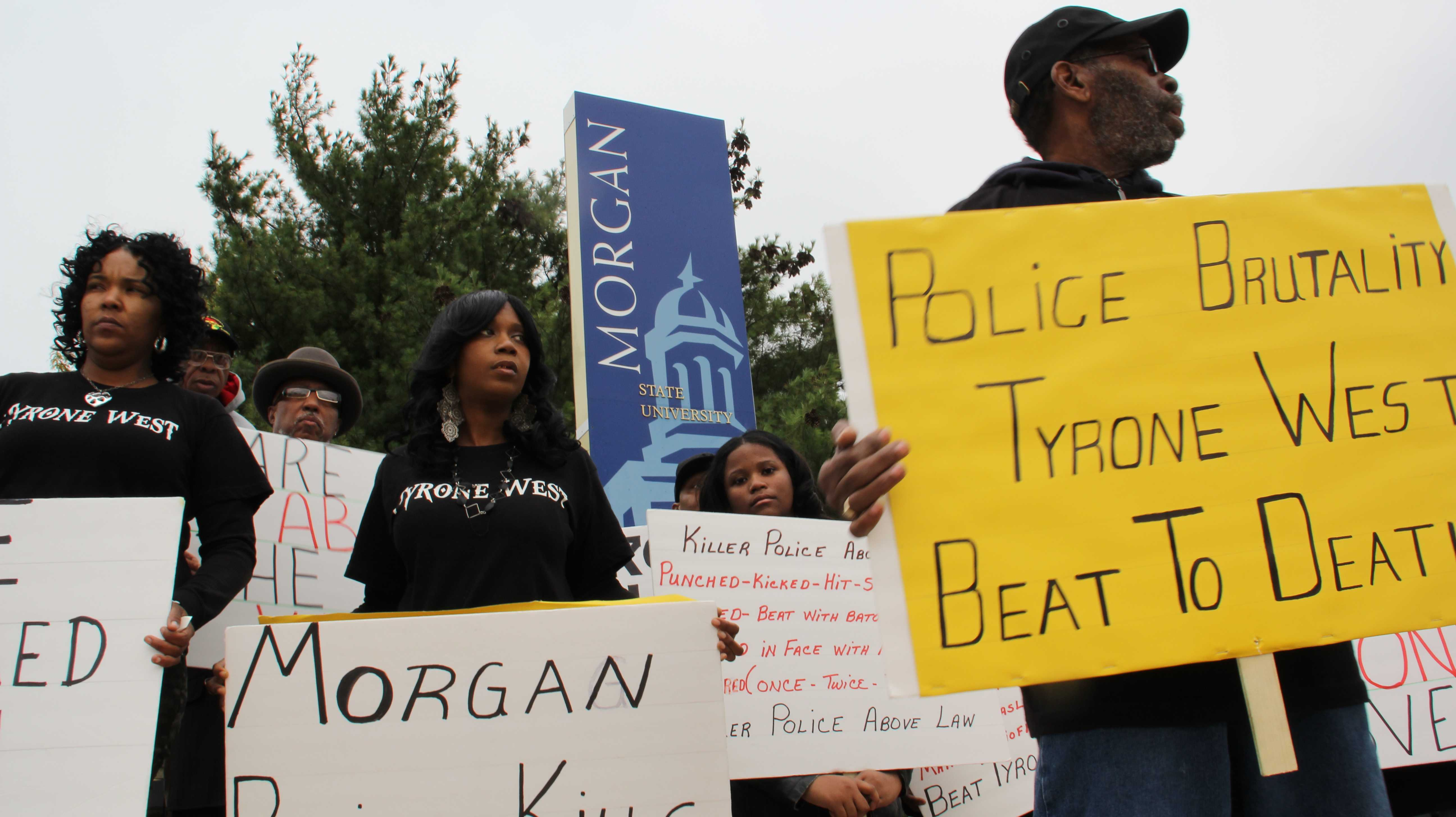 """Relatives, friends and supporters protest Tyrone West's death outside Northeast District police headquarters on a recent """"West Wednesday"""" (left to right): Jamie Richardson (West's cousin), Tawanda Jones (West's sister), George Peoples (West's uncle)"""