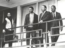 Martin Luther King, Hosea Williams, Jesse Jackson, Ralph Abernathy stand on the hotel balcony.