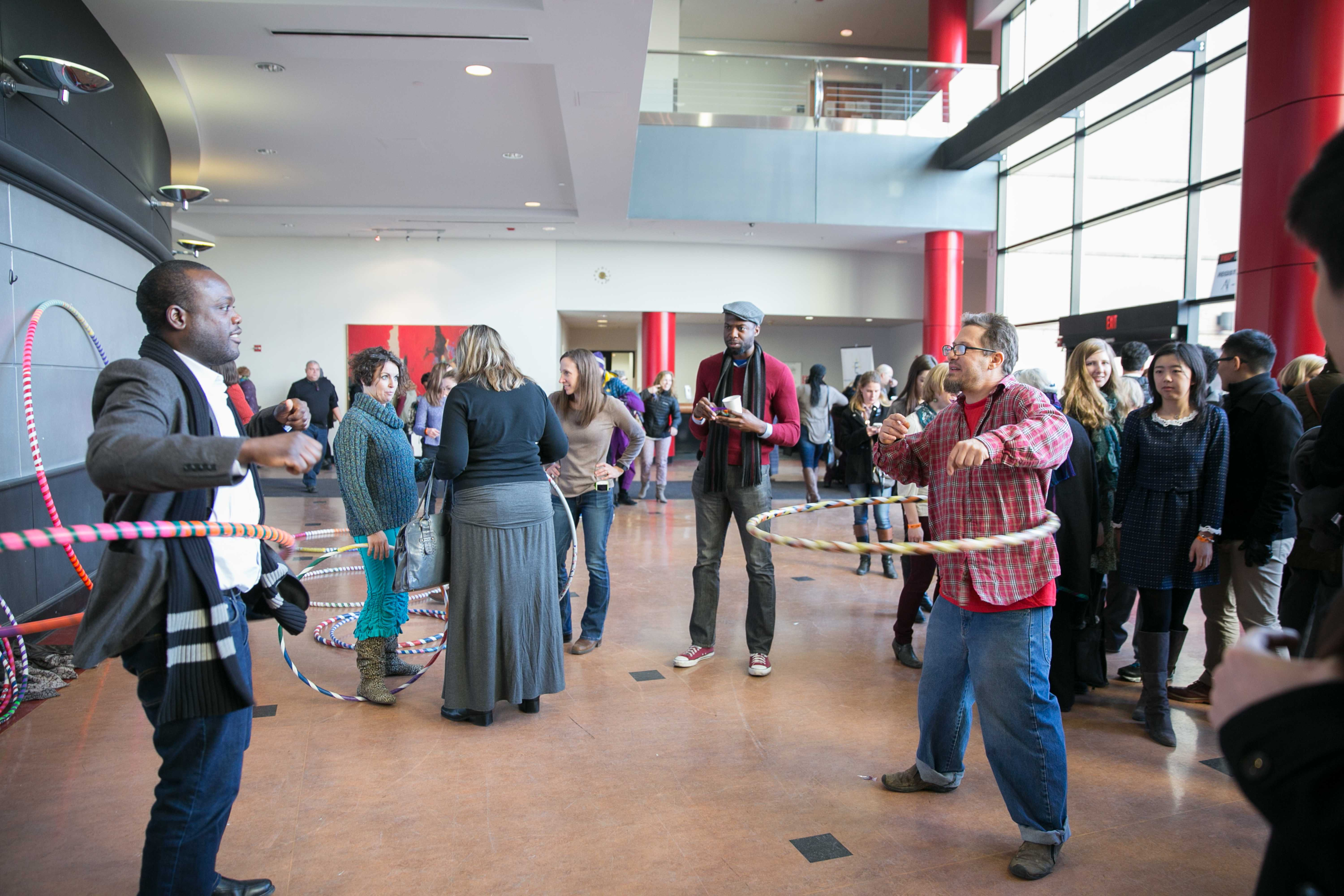 "Andreas ""Spilly"" Spiliadis hula hooping with audience members during the afternoon break."