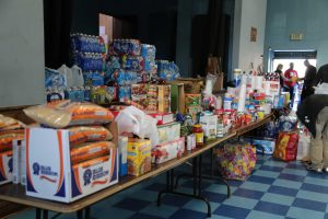 A table full of food at the St. Peter Claver Church's dinner and food drive.
