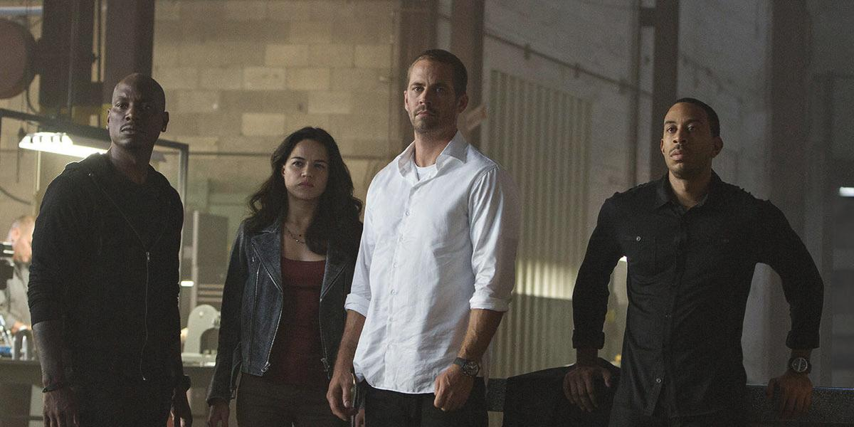 """The team reforms.  From left, Roman (Tyrese Gibson), Letty (Michelle Rodriguez), Brian (Paul Walker), and Tej (Chris """"Ludacris"""" Bridges)."""