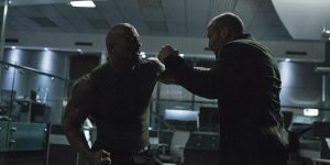 "Deckard Shaw (Jason Statham) and Luke Hobbs (Dwayne ""The Rock"" Johnson) battle in the DSS offices."