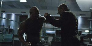 "Deckard Shaw (Jason Statham) and Luke Hobbs (Dwayne ""The Rock"" Johnson) battle in the DSS offices."