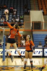 Sophomore Michaela Collins prepares to score as senior Carmen Fernandez looks on. Photo by Benjamin McKnight III