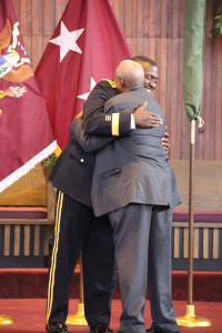 Brigadier General Raymond Scott Dingle and his father, Raymond, embrace after pinning on his new rank.