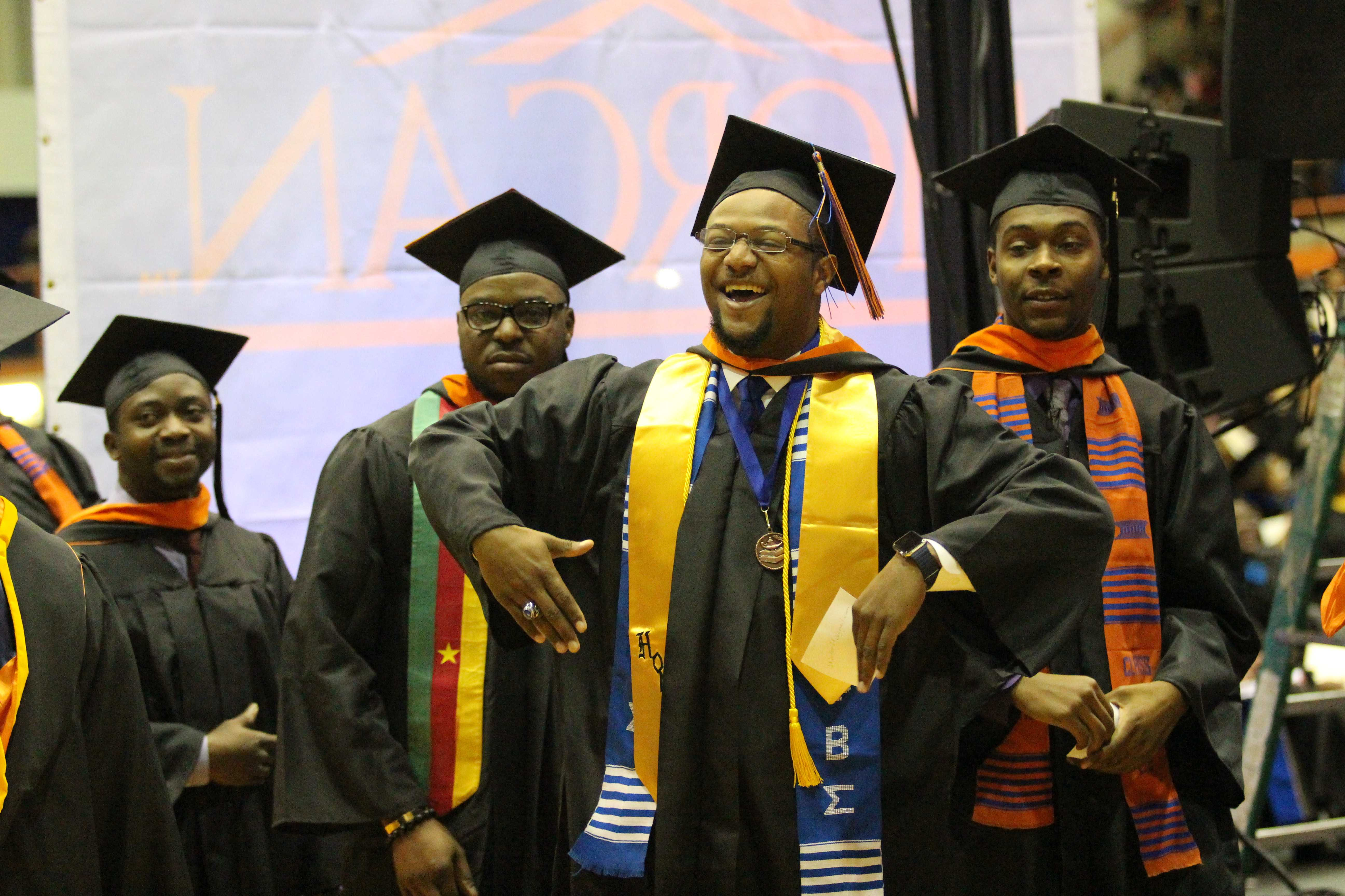 Jamal Butler celebrates on his way to the stage to be recognized as a Winter 2015 graduate. Photo by Benjamin McKnight III