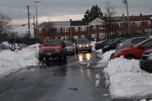 Morgan View residents park as best they can following the snow. Photo by Benjamin McKnight III.