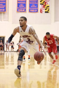 Senior guard Rasean Simpson begins to drive for a layup. Photo by Terry Wright