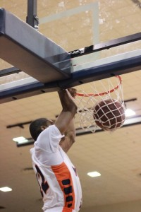 Sophomore forward Phillip Carr dunks in the second half against Howard. Photo by Terry Wright