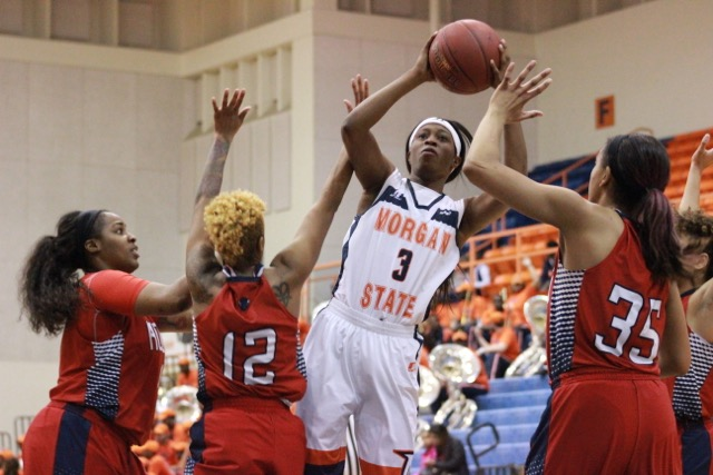 Sophomore forward Tykyrah Williams attempts a shot while contested by Lady Bison. Photo by Terry Wright.