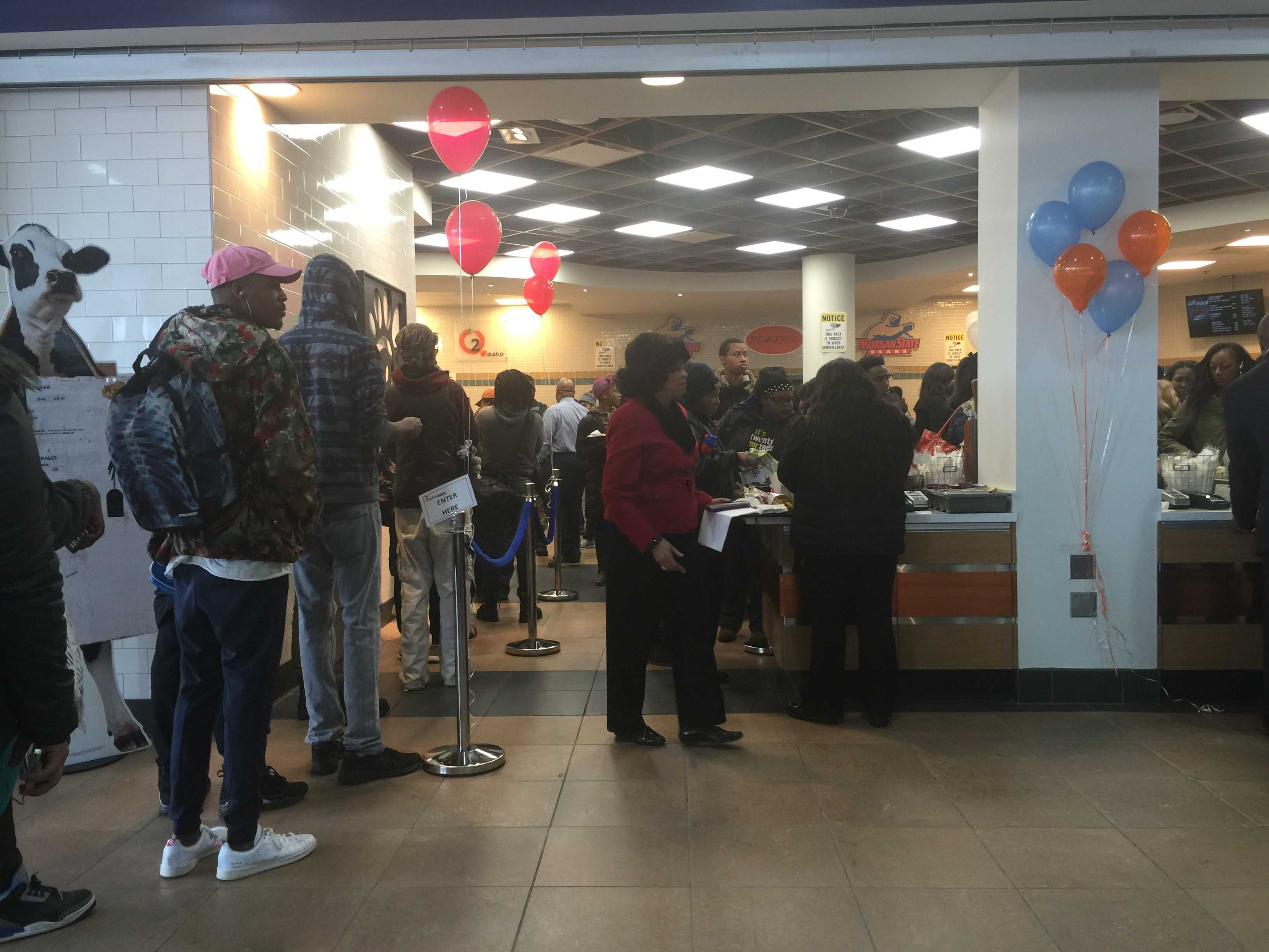 Students stand in line in the University Student Center Food Court during its reopening. Photo by Benjamin McKnight III