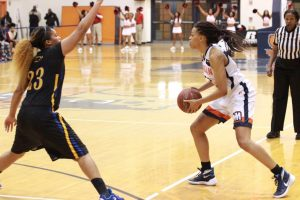 Senior Dinah Jones looks to pass to an open teammate against Coppin State University. Photo by Terry Wright.