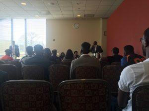 Photo of the Social justice Forum, with the brothers of S.M.O.O.T.H. Inc., and Councilman Nick Mosby