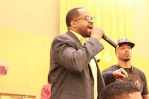 Councilman Nick Mosby addresses the crowd at the Iota Phi Theta Project X Stroll Off to remind students to vote. Photo by Terry Wright.