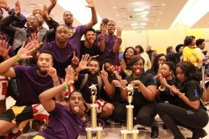 Omega Psi Phi and Sigma Gamma Rho celebrate after winning in their respective fields at the Project X Stroll Competition. Photo by Terry Wright.