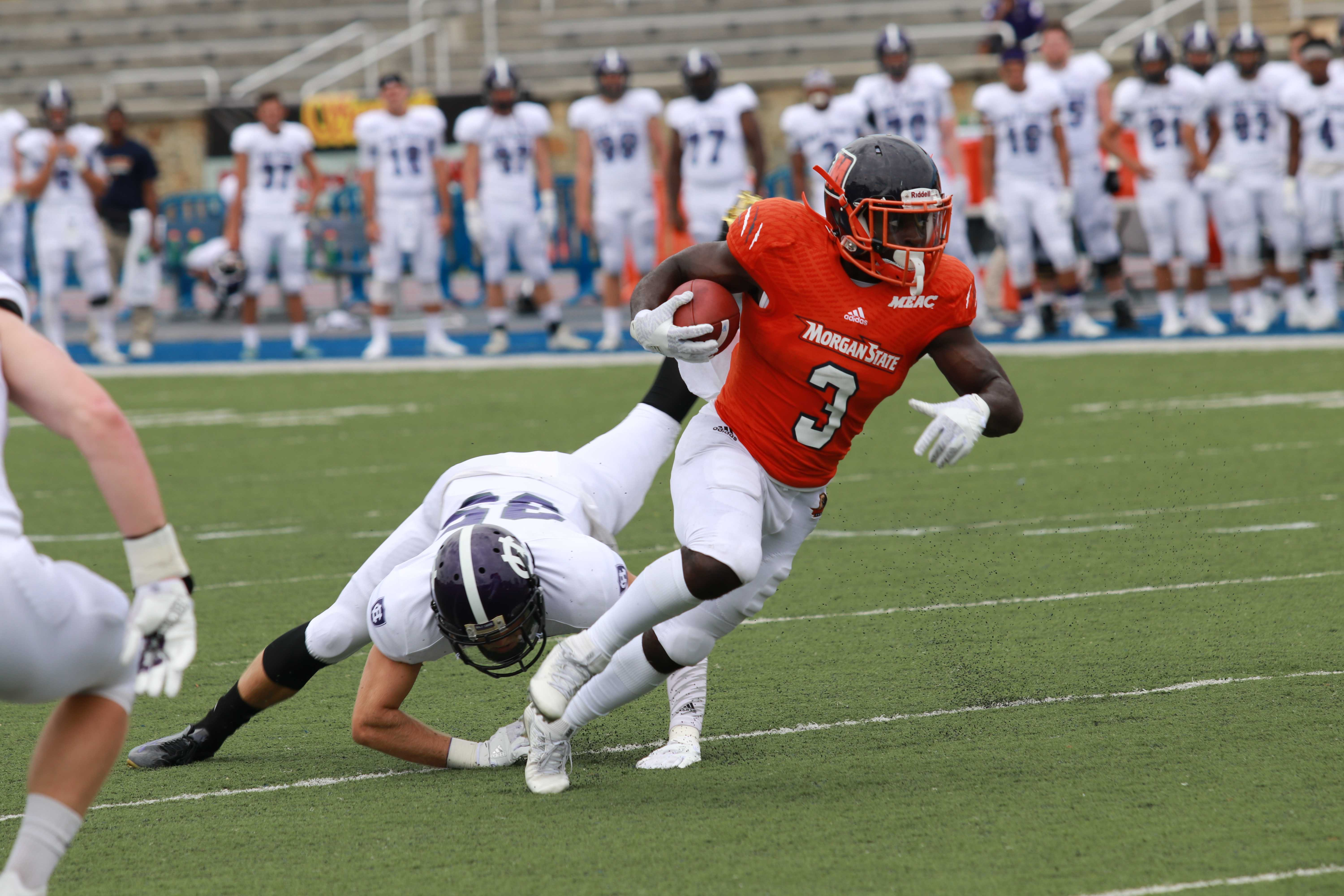 Herb Walker avoids Holy Cross tackler. Photo by Terry Wright.