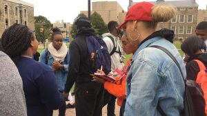 Kendra Hawkins talking to students, getting signatures for the petition. Photo credit: Penelope Blackwell