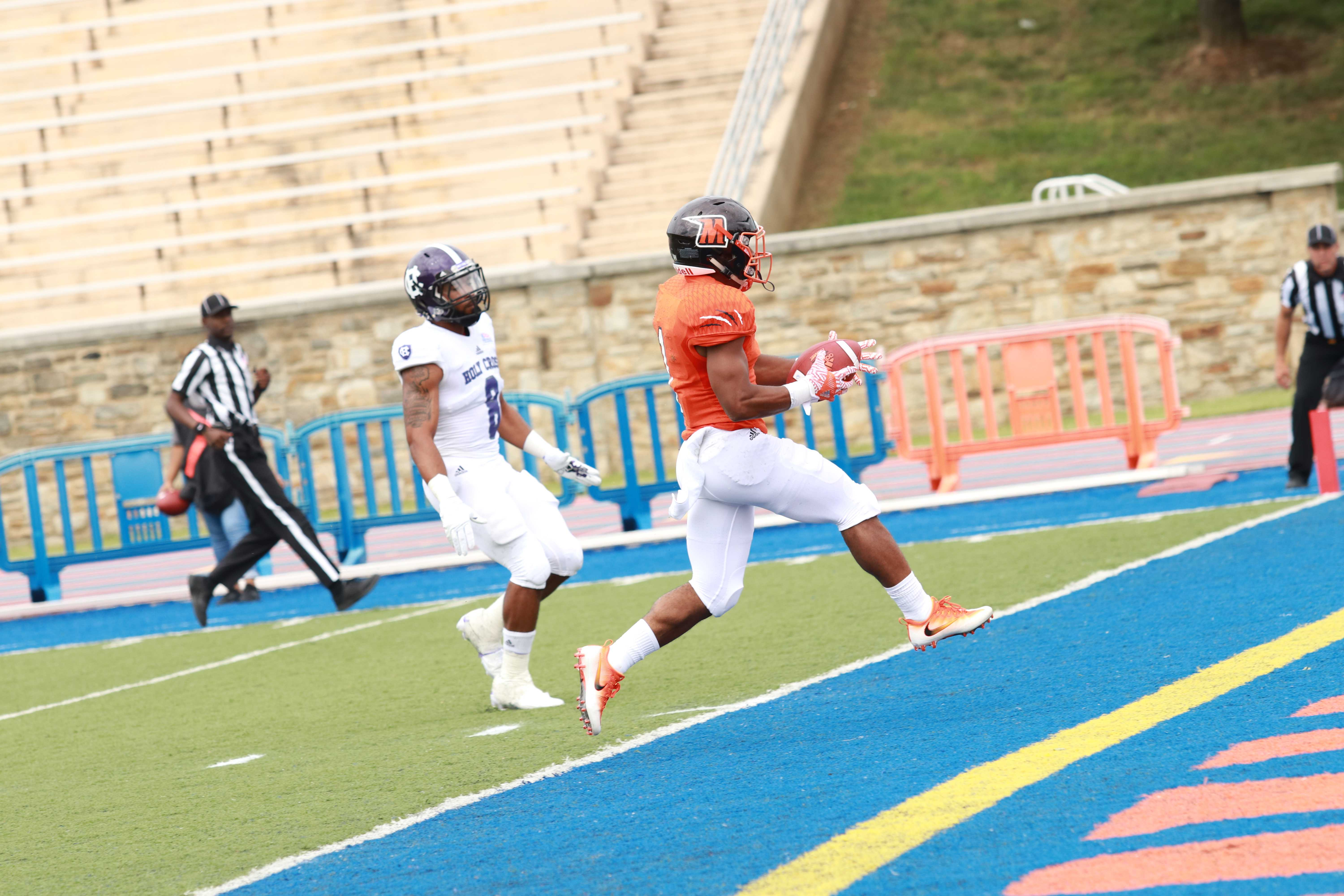 Orlando Johnson runs into the end zone for a first quarter touchdown against Holy Cross. Photo by Terry Wright.