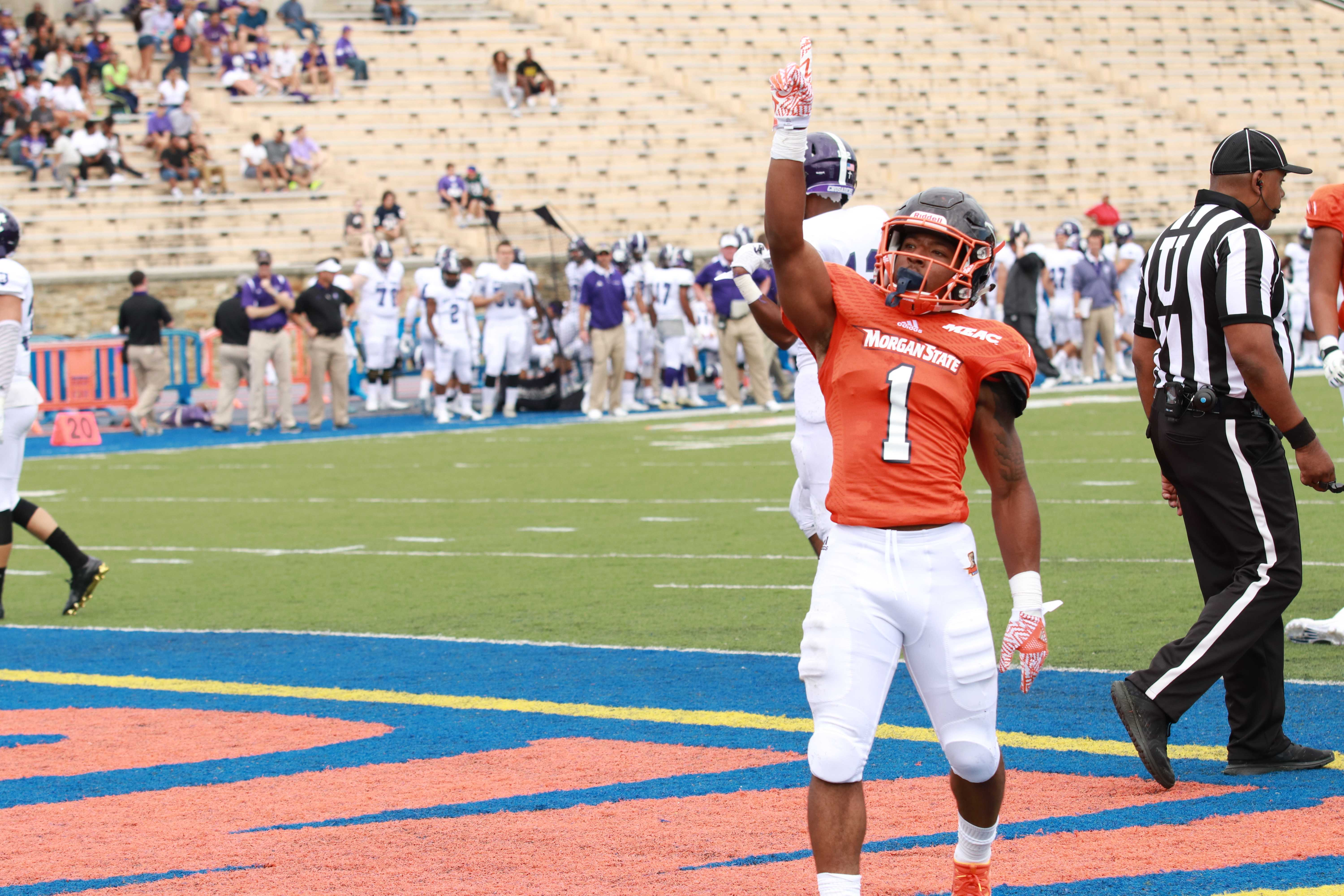 Senior running back Orlando Johnson celebrates after a touchdown against Holy Cross. Photo by Terry Wright.