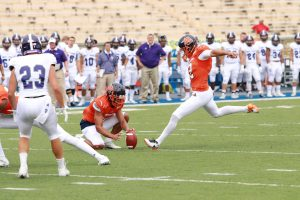 Sophomore kicker Alex Raya converts an extra point against Holy Cross. Photo by Terry Wright.