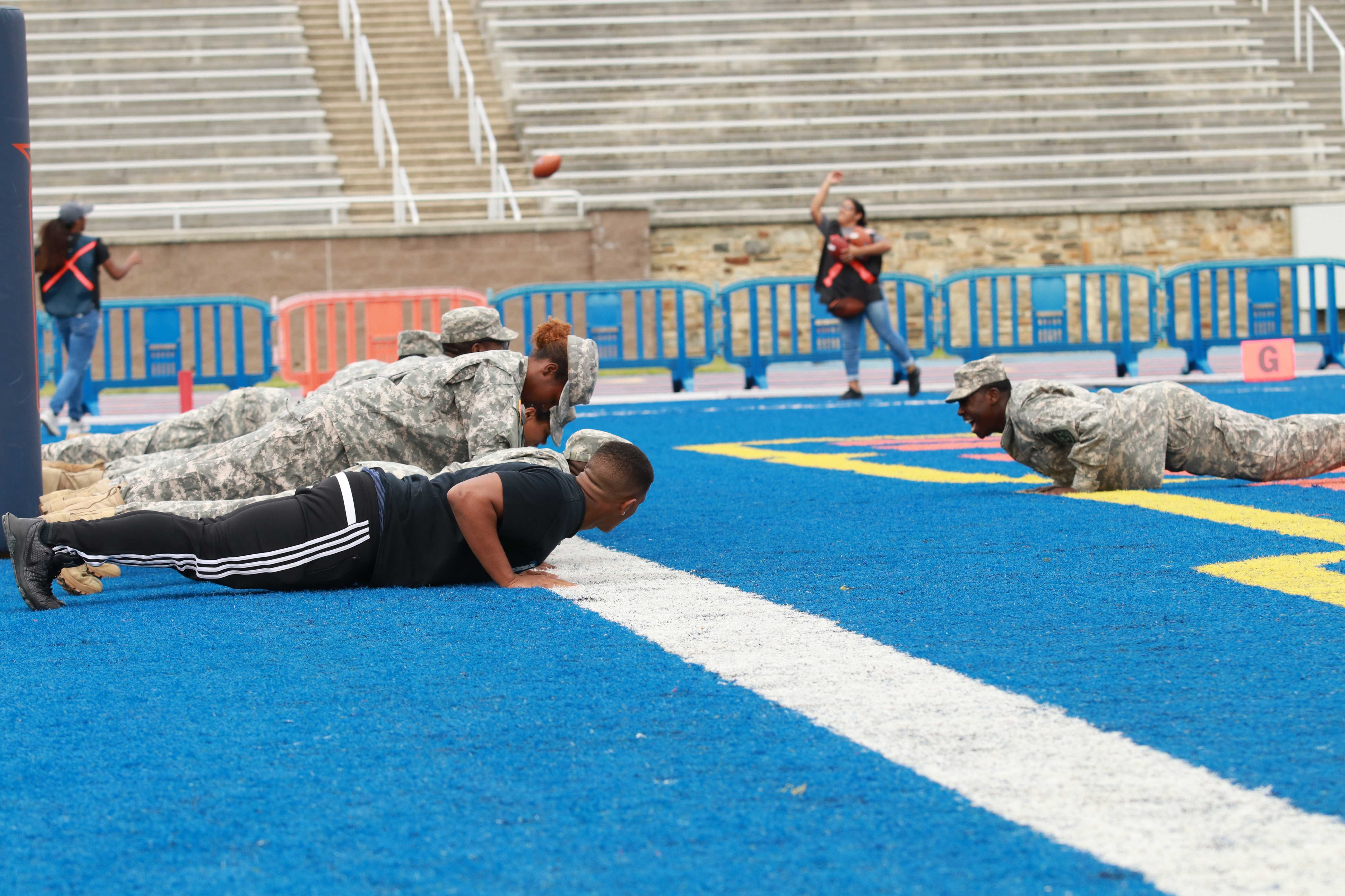 Members of the Morgan State Bear Battalion complete push ups after the Bears scored against Photo by Terry Wright. Photo by Terry Wright.