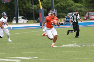 Graduate quarterback Chris Andrews scans the field against Holy Cross. Photo by Terry Wright.