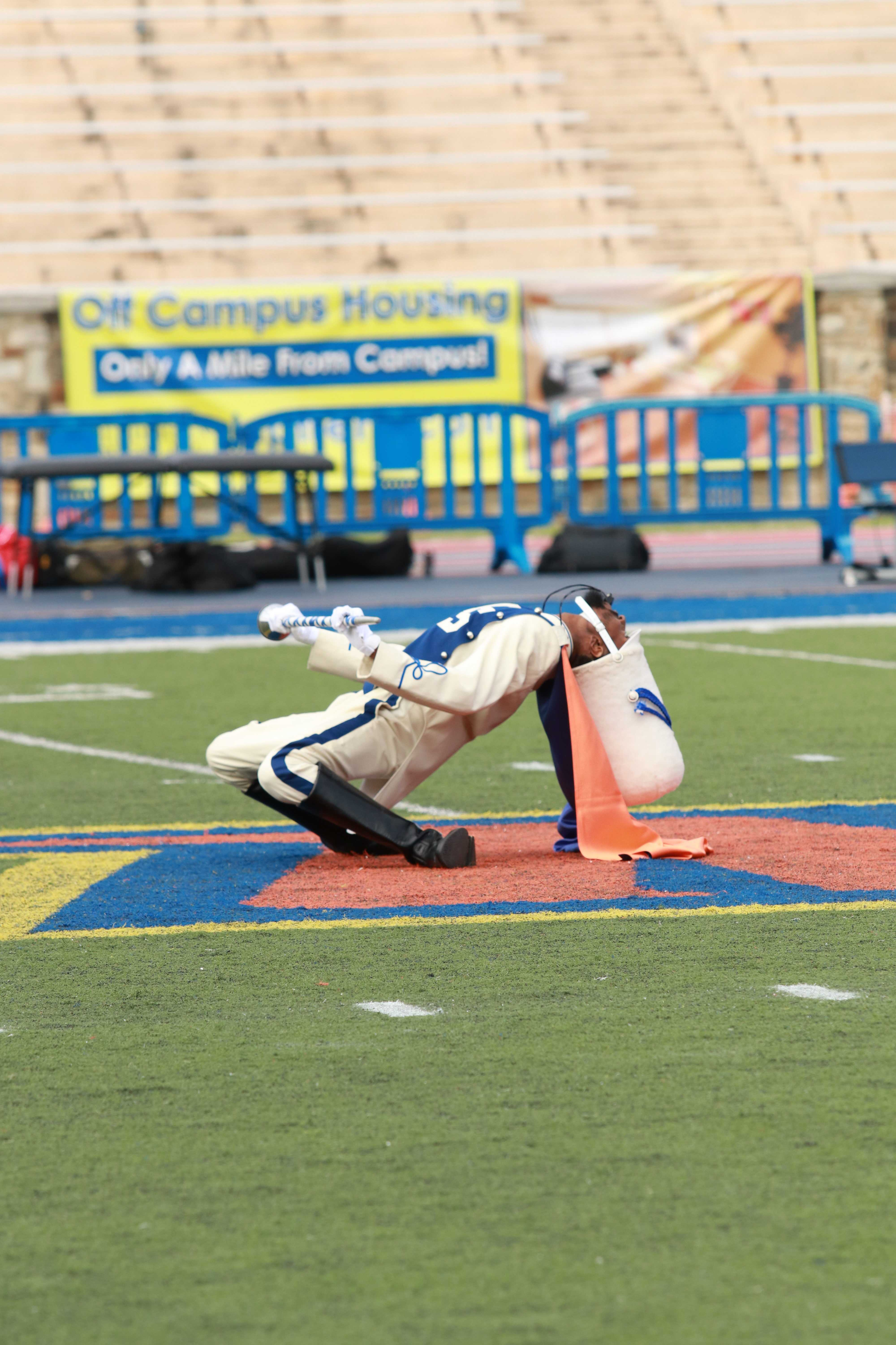 The drum major for the Magnificent Marching Machine begins the halftime show against Holy Cross. Photo by Terry Wright.