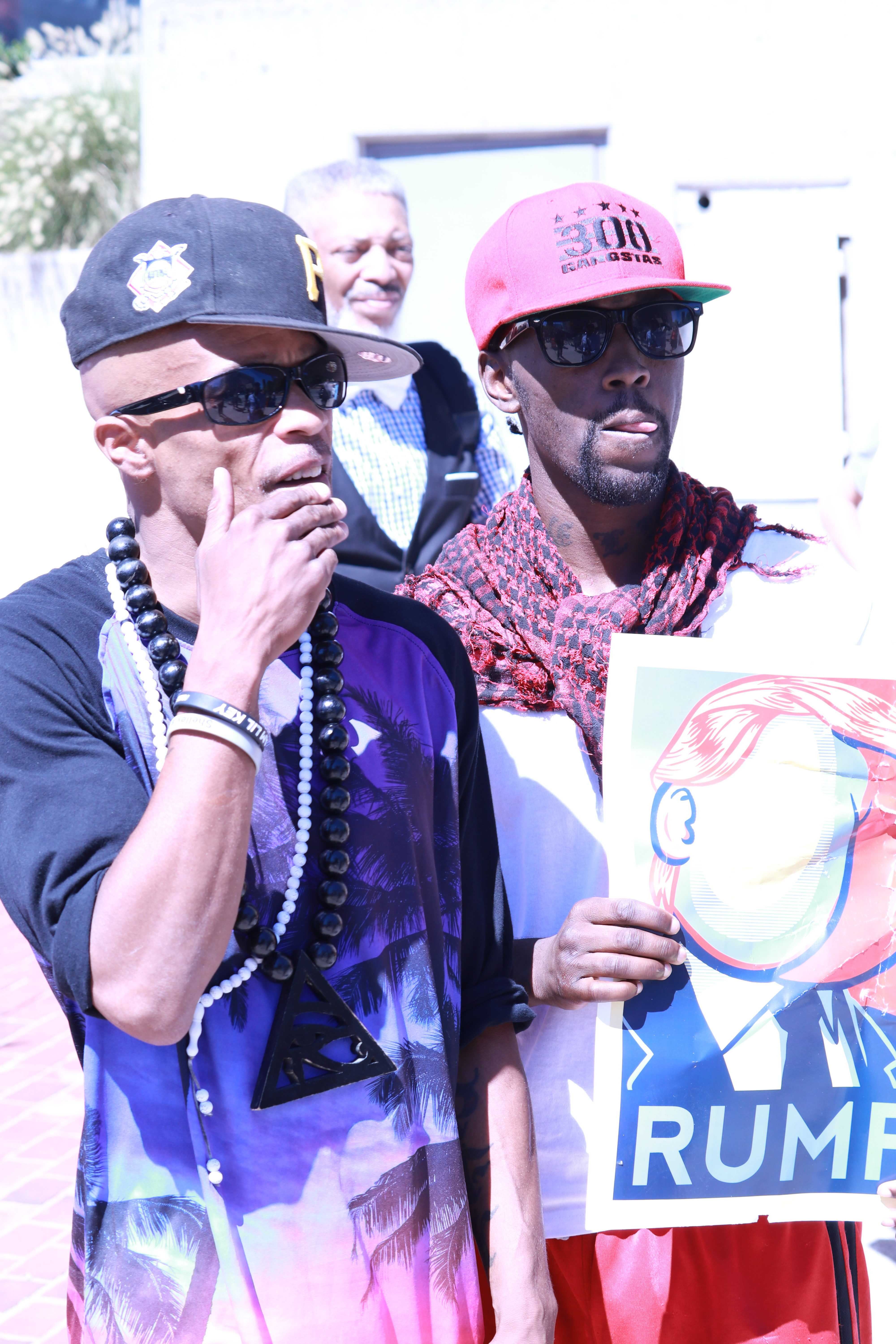 PFK Boom, left, and a fellow activist demonstrate outside of the Baltimore Convention Center. Photo by Terry Wright