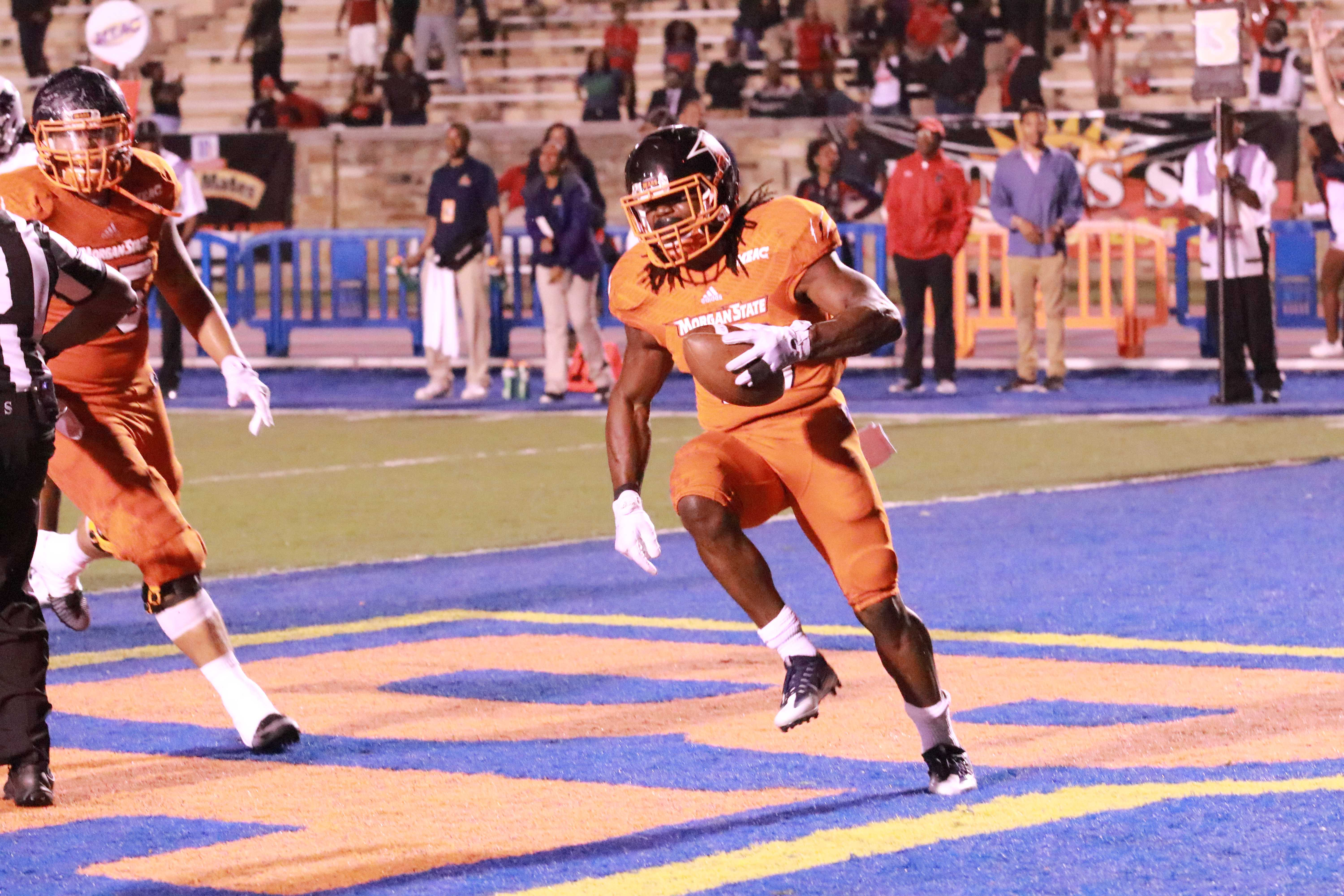 Sophomore running back Eric Harrell celebrates after scoring the go-ahead touchdown in the 4th quarter. Photo by Terry Wright.