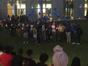 Brothers from Morgan State's S.M.O.O.T.H. (Strong Men Overcoming Obstacles Through Hard Work) honoring Marcus Edwards. Photo credit Devon Ashby