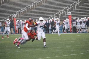 Morgan State defenders attempt to tackle a Delaware State player in Saturday's home contest. Photo by Terry Wright.