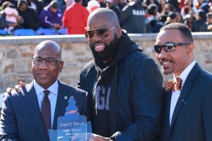 "Morgan alum and producer of ""Almost Christmas"" David Talbert (center) along with campus president David Wilson (left) and Kweisi Mfume (right) at halftime of Saturday's homecoming game against NCCU."