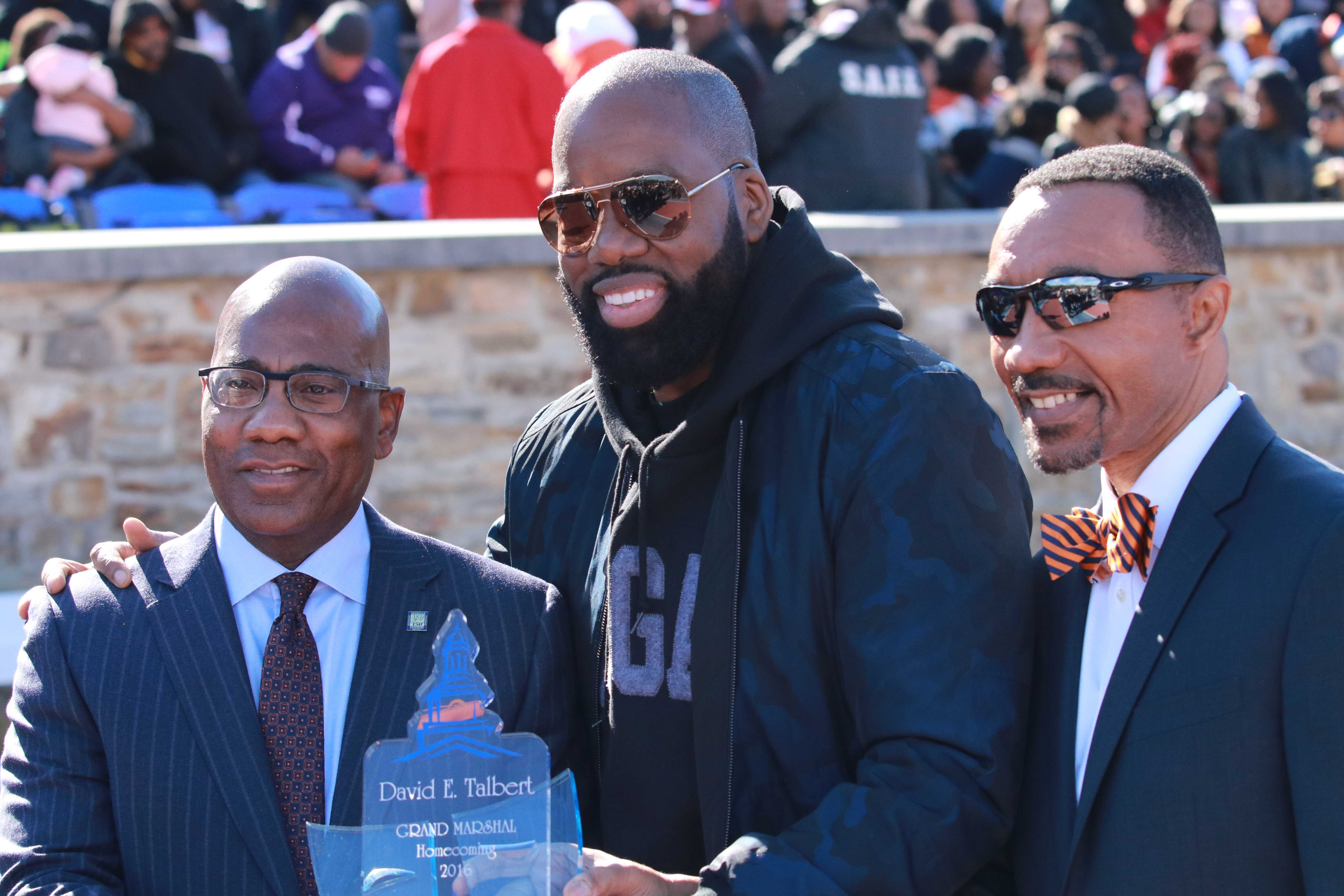 """Morgan alum and producer of """"Almost Christmas"""" David Talbert (center) along with campus president David Wilson (left) and Kweisi Mfume (right) at halftime of Saturday's homecoming game against NCCU."""