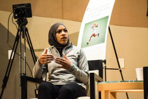Olympic fencer Ibtihaj Muhammad answers a question from Tuesday's symposium. Photo by Reginald Thomas II.