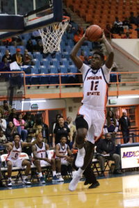 Junior Alex Ennis rises up for a dunk in Tuesday's loss to High Point. Photo by Terry Wright.