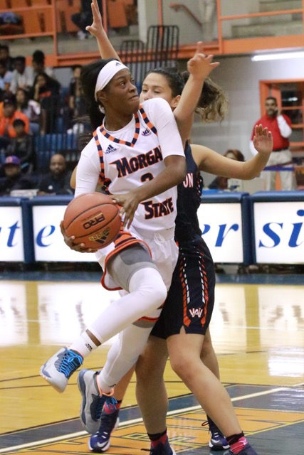 Junior Tykyrah Williams attempts a layup against Washington Adventist. Photo by Terry Wright.