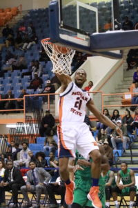 Senior Kyle Thomas completes a dunk against Wilmington University. Photo by Terry Wright