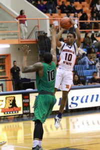 Sophomore guard Antonio Gillespie puts up a shot against Wilmington University. Photo by Terry Wright.
