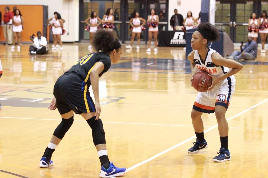 Senior Ivy Harrington prepares to make a move in last season's home contest against Coppin State University. Photo by Terry Wright