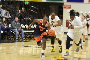 Jayde Duncan drives down the court following a steal against UMBC. Photo by Benjamin McKnight III.