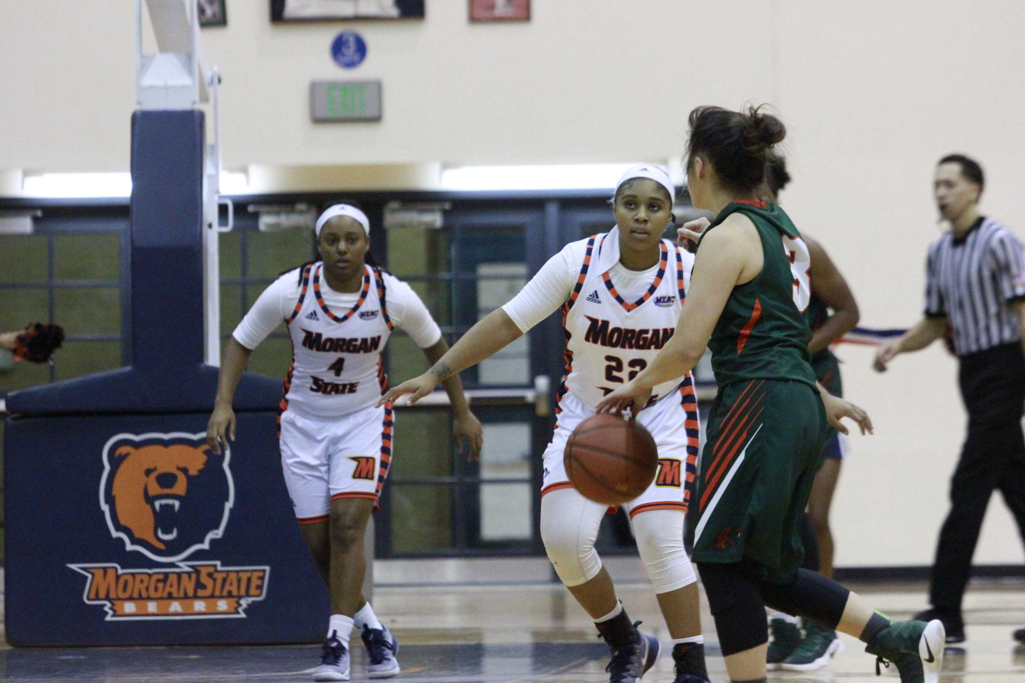 Freshman guards Kaylin Ellis (22) and Jihayah Chavis (4) defend the basket in the second half of a 61-26 loss to FAMU. Photo by Wyman Jones