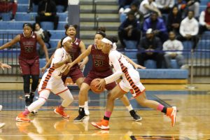 Senior guard Ivy Harrington makes a move the visiting NCCU Lady Eagles defense in a 44-42 win. Photo by Wyman Jones.