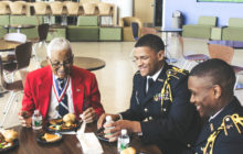 From left to right, Retired Col. Charles McGee, Reginald Rogers, and Charles Muondi at the Tuskegee Airman Symposium luncheon. Photo by Maliik Obee.