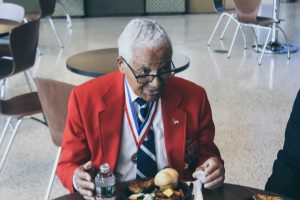 Retired Col. Charles McGee listening to cadets during the Tuskegee Airman Symposium luncheon. Photo by Maliik Obee.