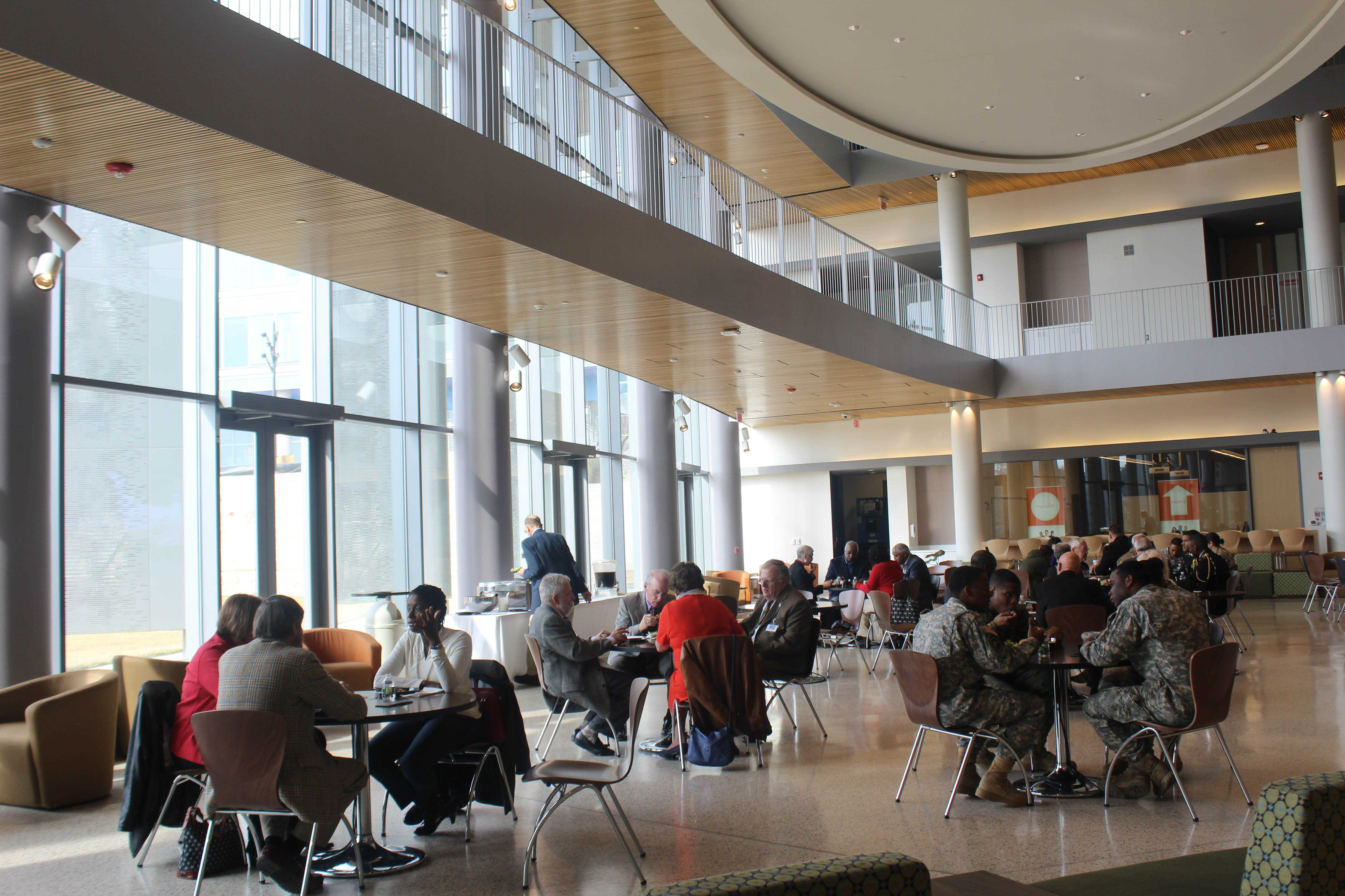 Attendees of the Tuskegee Airman Symposium eating lunch in the Earl G. Graves School of Business. Photo by Maliik Obee.